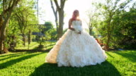 MS PAN Smiling young woman in backyard dressed in quinceanera gown