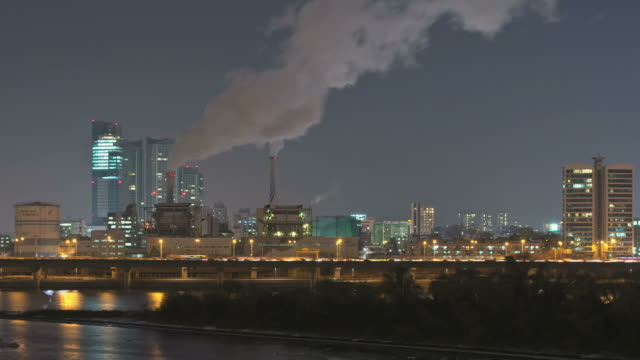 WS T/L Smock coming from Coal-fired Power Station along Gangbyeonbungno express way bridge at night / Seoul, South Korea