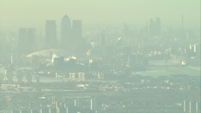 Smog encompasses the London skyline. Available in HD.