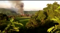 Smoke and flames rise from the Nonda Khali village of Maungdaw in Rakhine State western Myanmar on September 18 2017 Myanmar army has burnt over 60...