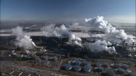 Smoke billows from the Oil Sands refinery.