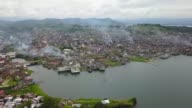Smoke could be seen rising from damaged buildings in the city of Marawi on Thursday as Philippine troops continue their advance to clear out ISgroup...