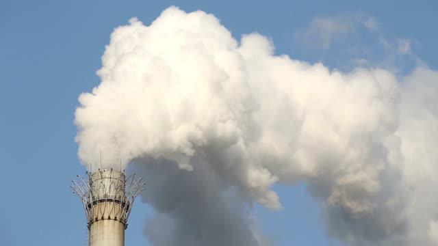 Smoke emitting from factory smoke stack