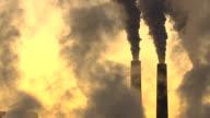 MS Smoke in sky at Navajo Generating Station with smokestacks during sunrise / Arizona, United States