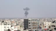 Smoke is seen billowing from an Israeli air strike in Rafah in the southern of Gaza Strip on Tuesday