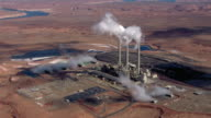 Smoke pours out of smokestacks at the Navajo Generating Station's coal-fired power plant in Arizona.