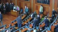 Smoke rises after the opposition lawmakers release tear gas canisters during a session at the Kosovo's Parliament in Pristina Kosovo on December 14...