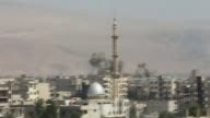 Smoke rises after the war crafts belonging to the Syrian army bombed the Arbin town in the eastern Gouta region of Damascus Syria on August 18 2015...