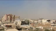 Smoke rises from Darayya of Damascus on September 20 after Assad regime forces stage an attack with barrel bombs