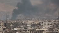 Smoke rises from Jobar district as opposition forces respond to Assad regime forces' attacks on March 20 2017 in Damascus Syria