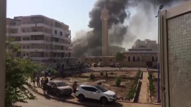 Smoke rises from the site of a suicide attack in Aden Yemen on November 14 2017 At least six soldiers were killed in a car bombing in Yemen's...