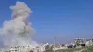 Smoke rises from the sites of the Russian air attacks and Syrians search for survivors in the rubble of buildings following the attacks on the second...