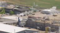 MS AERIAL Smoke stacks at Simplot Processing Plant / Caldwell, Idaho, United States