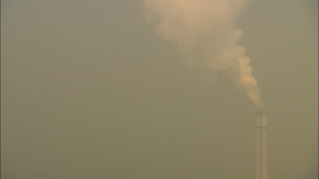MS HA Smokestack releasing white smoke into air thick with smog / Beijing, China