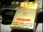 Smoking and impotency new warnings CSs Cigarette packets with variety of suggested warnings i/c CS Cigarette packet with warning 'Its not big and its...