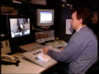 Beatles Abbey Road photograph doctored ENGLAND London GIR Man sat at television graphics suite with Beatles picture displayed on monitor CS Paul's...