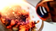 Smoking pot being burned close up