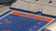 CU AERIAL ZO smurf turf at Broncos Stadium and reveal entire stadium / Boise, Idaho, United States