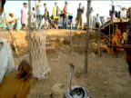 Snake charmers performing with snakes in baskets Goa