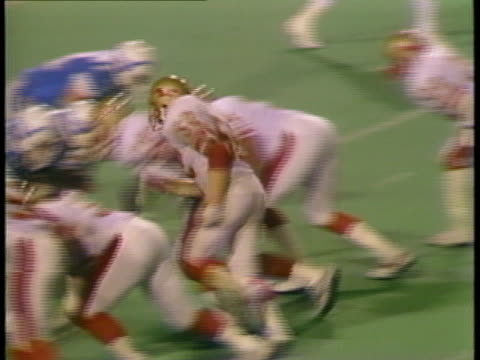 MS snapping of ball and Birmingham Stallions' Bill Roe being tackled in game against Portland Breakers/ Portland, Oregon