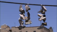 Sneakers hanging from electrical wire