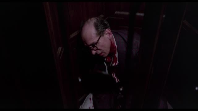 A sneezing man gets himself killed in hotel elevator