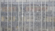 Snow at office building, defocused background, winter (HD720p)