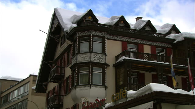 Snow blankets the rooftop of shops in Davos, Switzerland.