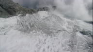 Snow blankets the rugged Swiss Alps. Available in HD.
