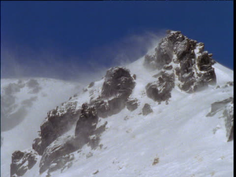 Snow blowing over snow capped peak, Southern Alps, South Island, New Zealand