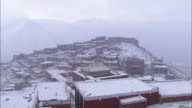Snow clings to a Tibetan village.
