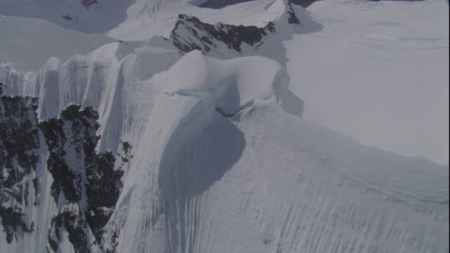 Snow clings to ridges and Antarctic mountain peaks. Available in HD