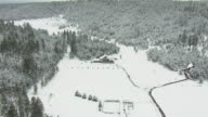 WS AERIAL Snow covered forest under grey sky in Coconino County / Arizona, United States