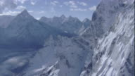 Snow covers the Himalayan Mountains in Nepal. Available in HD.