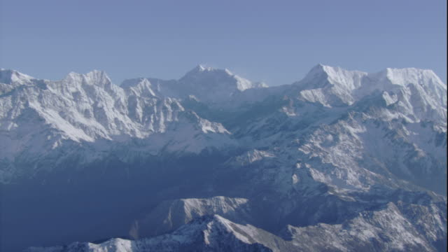 Snow covers the peaks in the Himalayas. Available in HD.