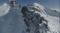 Snow covers the rugged ridges of the Swiss Alps. Available in HD.
