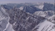 Snow dusts majestic mountains in Banff National Park. Available in HD.