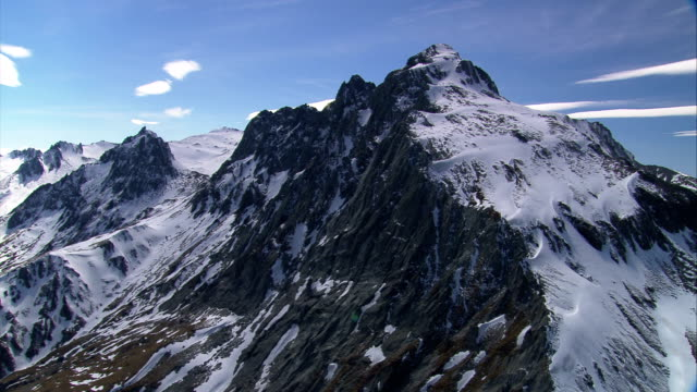 Snow dusts rugged mountain peaks in New Zealand. Available in HD.