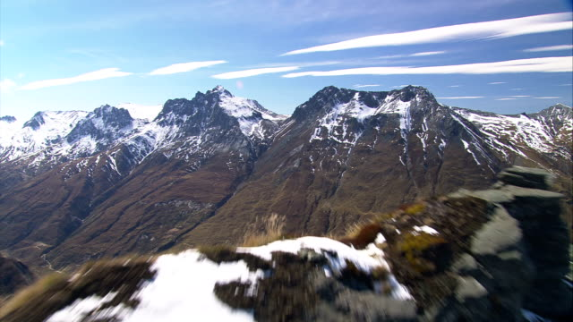 Snow dusts the jagged peaks of a mountain range in New Zealand. Available in HD.