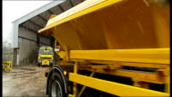 Gritters London Fields Lido Gritting lorries parked / Flashing lights on gritter / Gritting lorry leaving centre / Driver of griitter in cab /...