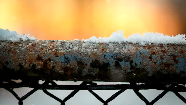 Snow on the old fence