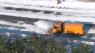MS AERIAL TS Snow plough clearing road / Gangwondo, South Korea