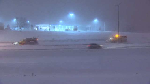 Snow Plow Drives Down Highway At Night Through Snow during the 5th Largest Blizzard in Chicago history on February 02 2015 in Chicago Illinois