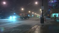 Snow plow drives down road as snow falls in Chicago on Nov 15 2014