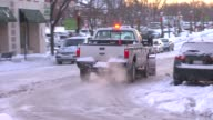 Snow Plow Going Down Street on January 02 2014 in Chicago Illinois