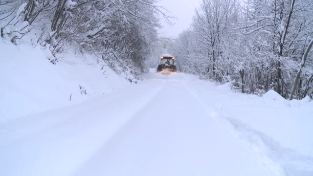 HD: Snow plow on winter road