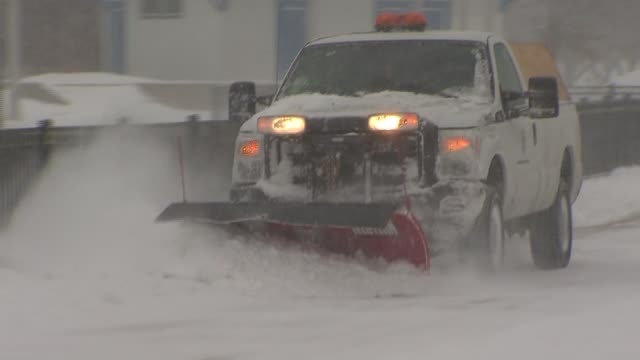 Snow Plow Pushing Snow On Street on January 06 2014 in Chicago Illinois