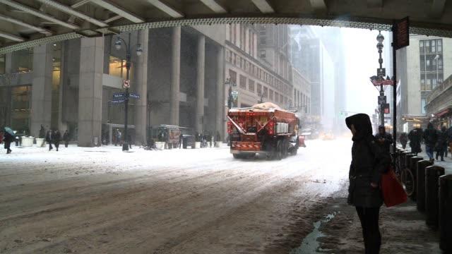 Snow plows and traffic struggle across 42nd Stin midtown / Park Avenue Viaduct Bridge Seen overhead
