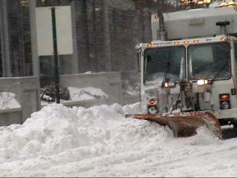 MS, ZO, Snow plows on street, Queensboro bridge in background, New York City, New York, USA