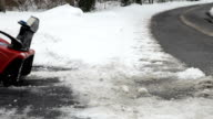 Snowblower Clearing Driveway